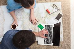 Couple planning trip, searching and paying online stock photo