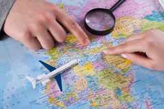 Couple planning trip to Turkey, point on map. Couple planning airplane trip to Turkey, point on map, top view stock image