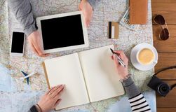 Couple planning vacation, search and notes. Couple planning travel. Searching or booking tickets online, taking notes in notebook, preparation for summer Royalty Free Stock Photography