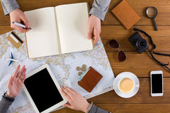 Couple planning vacation, search and notes. Couple planning travel. Searching or booking tickets online, taking notes in notebook, preparation for summer Stock Photography