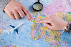Couple planning vacation trip with map. Top view. stock photo