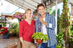Couple with plant in nursery shop Stock Photo