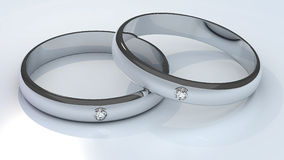 Couple of platinum diamond wedding rings on white  Stock Images
