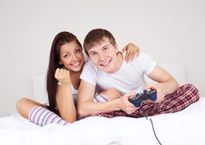 Couple play games. Happy young teenage couple playing computer games Royalty Free Stock Image