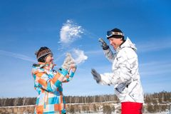 Couple play  in snow Stock Image