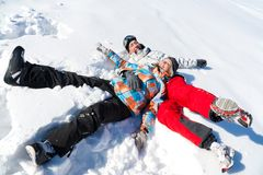 Couple play  in snow Stock Photography
