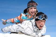 Couple play  in snow Royalty Free Stock Photography