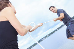 Couple play tug-of-war with rope Royalty Free Stock Photos