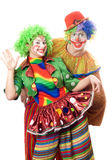 Couple of playful clowns Stock Images
