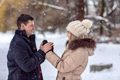 Couple playful together during winter holidays vacation outside royalty free stock images