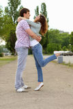 Couple of playful young people Stock Photos