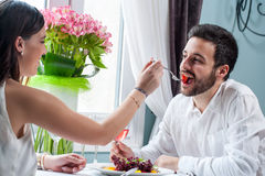 Couple playing around at dinner table. Royalty Free Stock Images