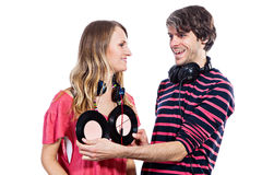 Couple playing around with vinyl records Royalty Free Stock Photography