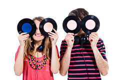 Couple playing around with vinyl records Stock Photography