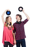 Couple playing around with vinyl records Royalty Free Stock Image