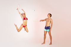 Couple playing badminton Stock Photography
