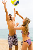Couple playing with a ball on the beach Royalty Free Stock Photography