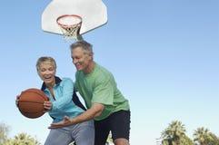 Couple Playing Basketball Stock Photo