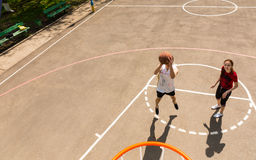 Couple Playing Basketball on Outdoor Court Stock Photo