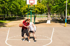 Couple Playing Basketball on Outdoor Court Stock Images