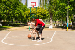 Couple Playing Basketball on Outdoor Court Royalty Free Stock Photos