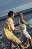 Couple Playing With Beach Ball. Happy African American couple playing with beach ball Stock Photo