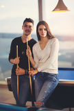 Couple playing billiard. In cafe Stock Photos
