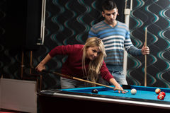 Couple Playing Billiard Stock Photography