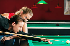 Couple playing billiards Stock Photography