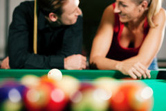 Couple playing billiards royalty free stock image