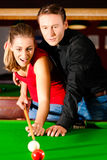 Couple playing billiards Royalty Free Stock Photography
