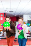 Couple playing Bowling Stock Photo