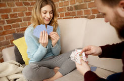 Couple playing with cards. Stock Photography