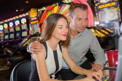 Couple playing in casino stock photos