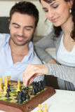 Couple playing chess Royalty Free Stock Photo