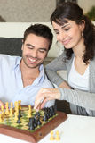 Couple playing chess Stock Image