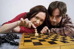 Couple playing chess game Stock Photos