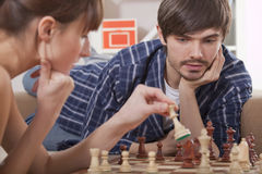 Couple playing chess game Stock Photography