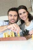 Couple playing chess stock photo