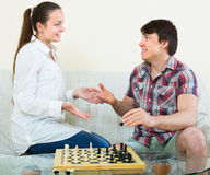 Couple playing chess at home Royalty Free Stock Photography