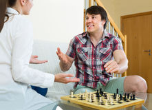 Couple playing chess at home Royalty Free Stock Images