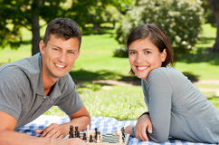 Couple playing chess in the park Stock Photos