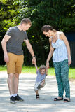 Couple playing with child Royalty Free Stock Photography