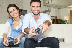 Couple playing computer games Stock Photo