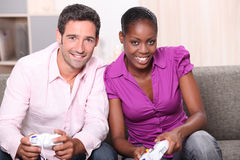 Couple playing computer games. At home Stock Photos