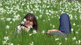 Couple playing in daffodils meadow, gentle touch. UHD 4K stock video