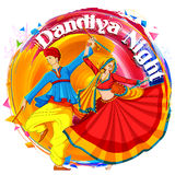 Couple playing Dandiya in disco Garba Night poster for Navratri Dussehra festival of India Royalty Free Stock Images