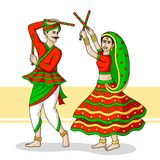 Couple playing Dandiya Stock Photo