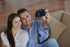 Couple playing with digital camera at home Royalty Free Stock Photos
