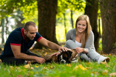 Couple Playing With Dog Royalty Free Stock Photos